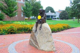 Statue of Indian-Downtown Hyannis, statue of Indian (holding a yellow balloon) (medium sized photo)